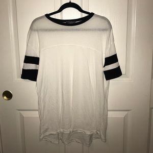 A white t shirt dress with black striped sleeves
