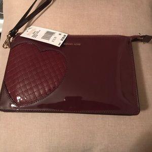 Michael Kors | Burgundy patent leather Wristlet