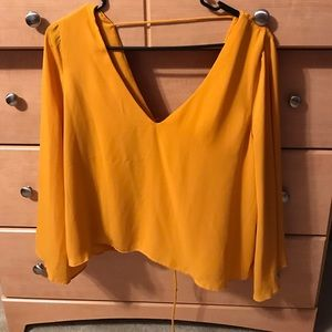 Mustard blouse with trumpet sleeve and laceup back