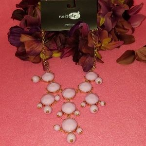 Pink and gold tone neckless