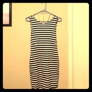Open back, black and white striped dress. Classic.