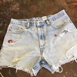 Distressed vintage Levi's 550 cutoff jean shorts