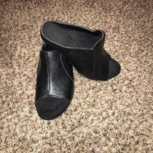 Black leather slip on heels