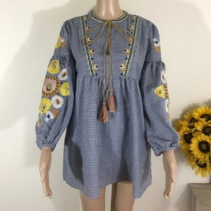 Embroidered mini dress with PomPoms