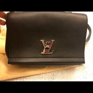Louis Vuitton leather body cross bag