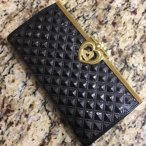 Black clutch with heart shaped clasp - Never used