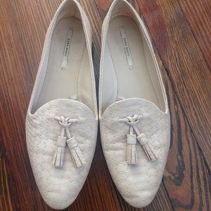 Lightly-worn beige tassel loafers