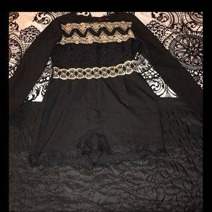 Long sleeve romper with decorative lace