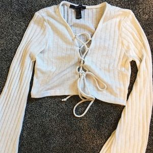Crop top with lace up front and bell sleeves
