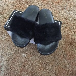 Black fuzzy slides/slippers  comes with box