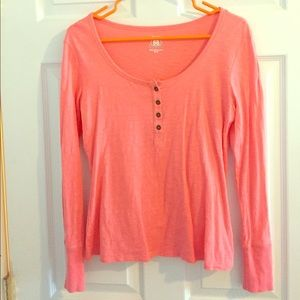 Peach long sleeved 4 buttoned top.