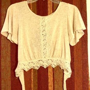 Open back crop top w/ lace details! Lightly worn