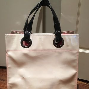 Vinyl shiny cream tote bag with cool red interior