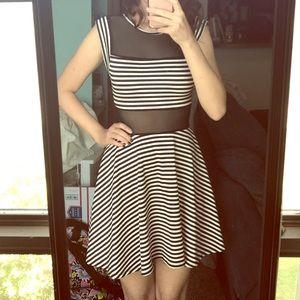 B&W striped skater dress with trendy mesh detail