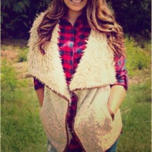 Faux shearling vest with faux leather trim