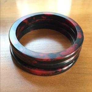 Set of three red and black plastic bangles.