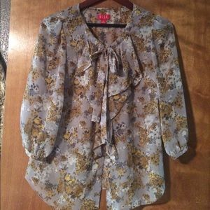 Stunning floral pussybow ruffled blouse