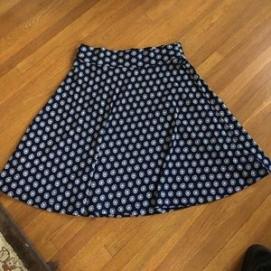 Adorable navy blue and white flippy skirt.