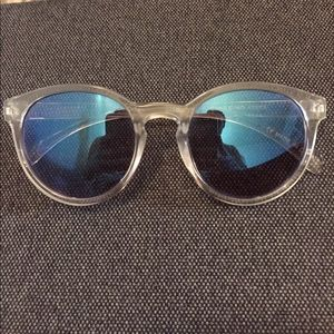 Round Sunglasses with clear frame and blue lenses