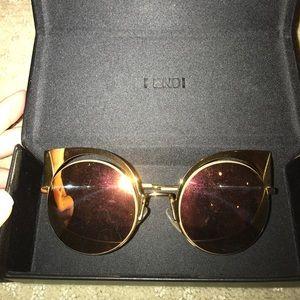 Fendi sunglasses in gold
