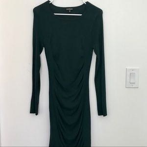 Deep green body hugging sweater dress