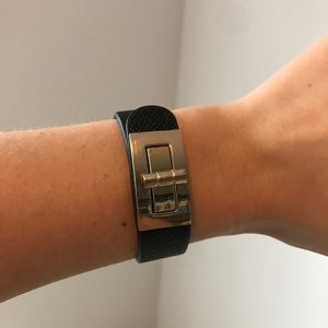 Black leather bracelet with gold switch closure