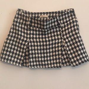 Herringbone mini skirt.