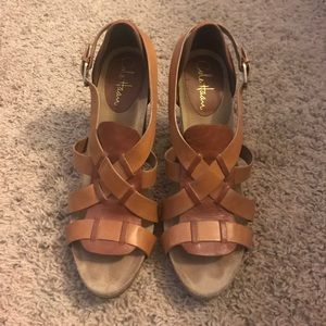 Cole Haan tan leather sandals.
