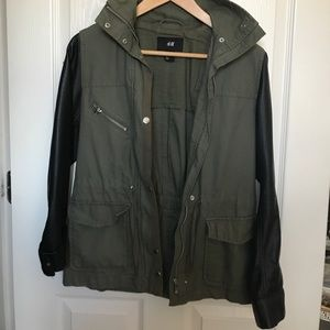 olive green jacket with leather sleeves