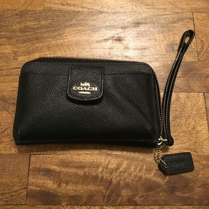 Black Coach wallet with wrist band