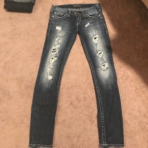 Dark distressed silver jeans