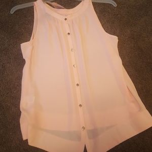 Tank with buttons in back