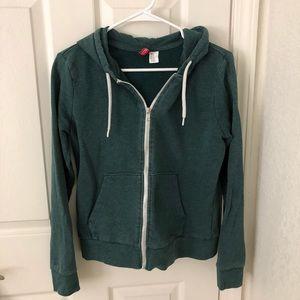 green zip up hoodie