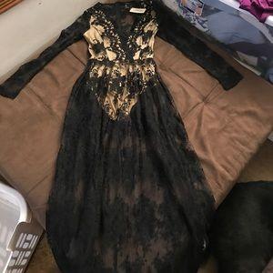 Cream bodysuit with black lace overlay