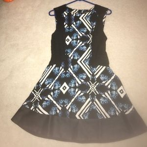 Pattern dress with leather trim
