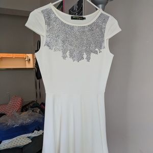 White jersey dress with crystal detail neckline