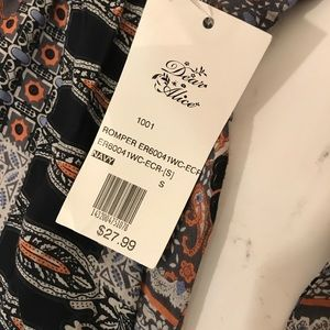 817ca177eba en creme Pants - Dear Alice En Creme Romper Size Small