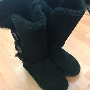 Size 10 black UGGs with three buttons going up