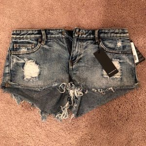 Never before worn! Ripped shorts