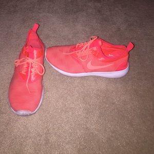 Orange Nike Flex tennis shoes