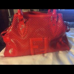 Fendi red patent leather handbag.