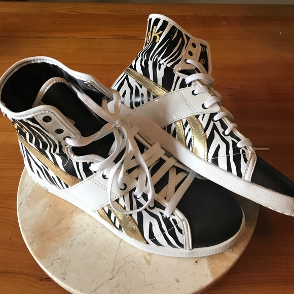 4c7df9ed52b8 Gold and Zebra Reebok High Tops