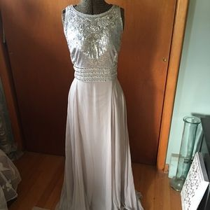 NWT. JS Collections Silver Sequin Sleeveless Gown