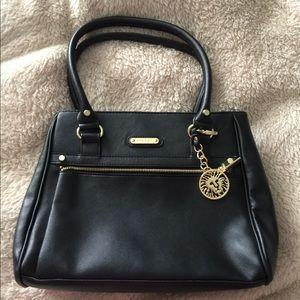 Black Anne Klein handbag with gold accents