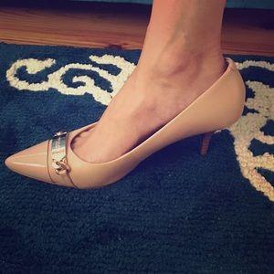 Nude coach heels