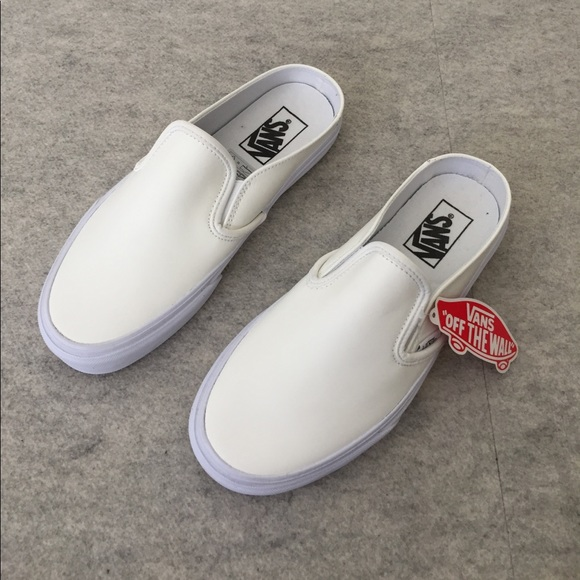 vans slip on white on feet