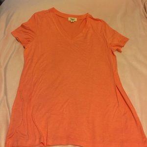 Orange V-neck shirt