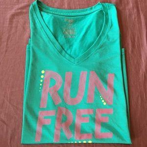 "Green ""run free"" dry fit T-shirt size M"