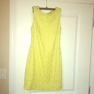 Bright yellow dress with flower detail