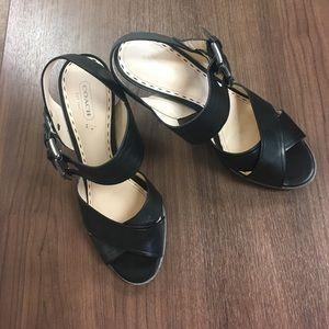 Lightly worn coach black sandals 8 1/2 heals solid